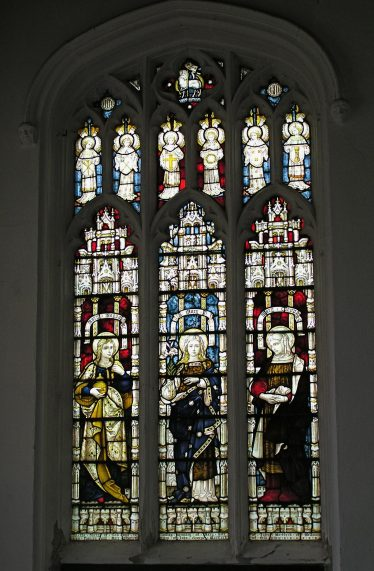 The stained glass in the east window of the south wall of the south aisle shows how the tracery was used  to expand the iconography of the main lancets, here with the Lamb of god in the apex and a choir of angels below.   Peter Draper