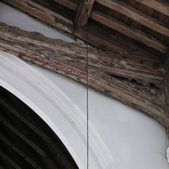 Nave, 15thc king-post roof, original painted decoration on eastern truss | Peter Draper