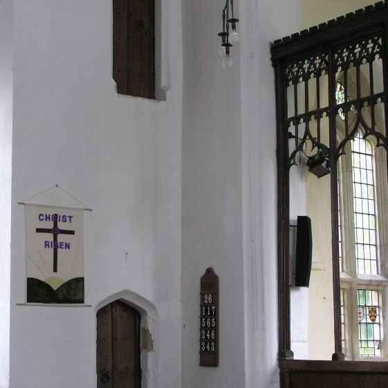 Chancel screen doors leading to staircase added on the exterior. The doors show that the screen was originally much wider, with the upper door leading to a gallery across the top | Peter Draper