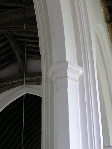 The semi-octagonal, moulded capitals of the nave arcade. Note, too, the sharply-defined, continuous mouldings   Peter Draper