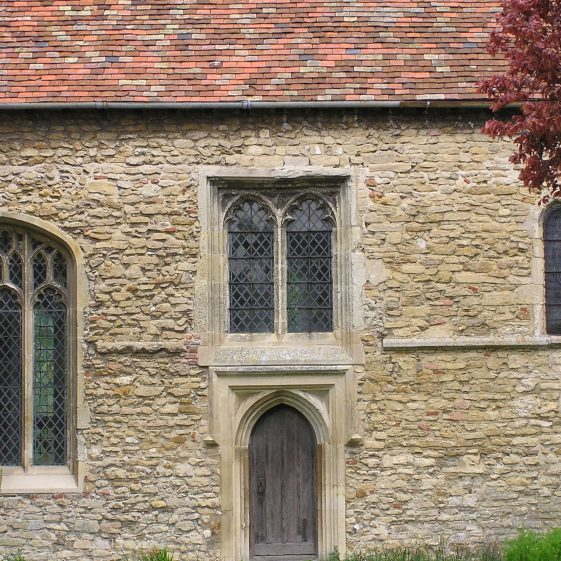 Chancel, exterior south side showing 15thc insertions of priest's door and adjacent window | Peter Draper