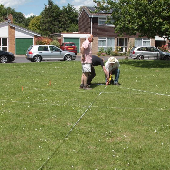 Flambards Green: Measuring the Site for the Geophys Survey | Photograph by Malcolm Woods
