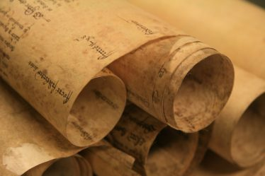 Early manorial court rolls were made of membranes of parchment stitched together at the top. | Essex Record Office