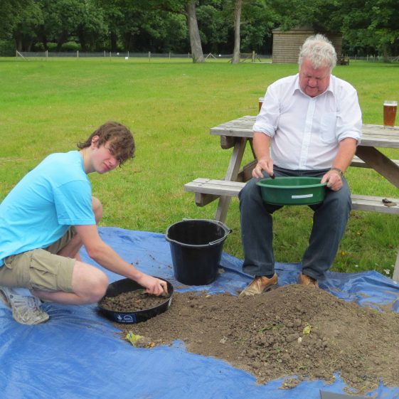 Andrew Betts (left) and Alex Laurie sieving the soil | Photograph by Kathryn Betts