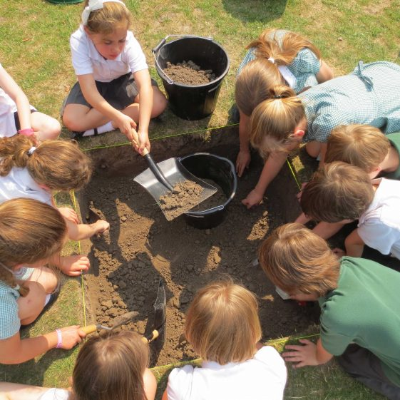 Meldreth Primary School children working on the test pit | Photograph by Kathryn Betts