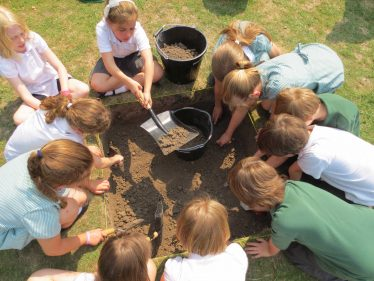 Meldreth Primary School children working on the school test pit, 5th July 2013 | Photograph by Kathryn Betts