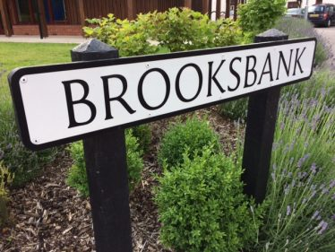 The road in Melbourn, next to 'The Hub', where the Police Station once stood, named after Ron Brooksbank | John Crawforth, June 2016