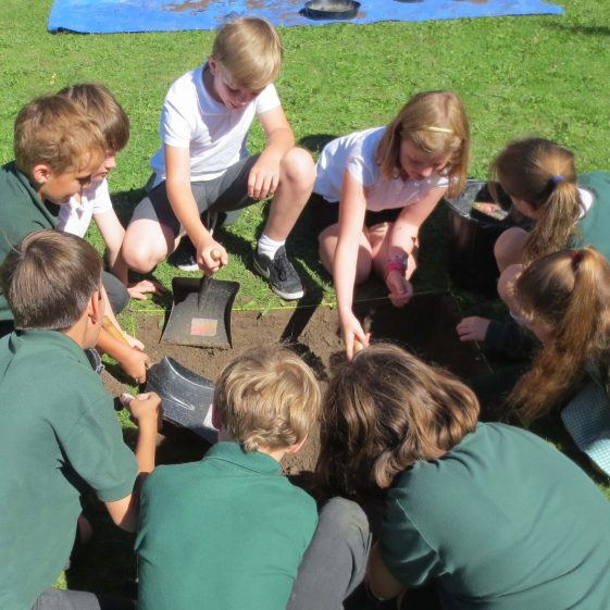 Primary School pupils working on their test pit | Photograph by Kathryn Betts