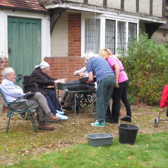 Residents and staff of Maycroft Care Home washing the finds | Photograph by Kathryn Betts