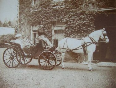 JG and his wife Catherine outside Meldreth Court ~1910.  The coachman is John Ransome.