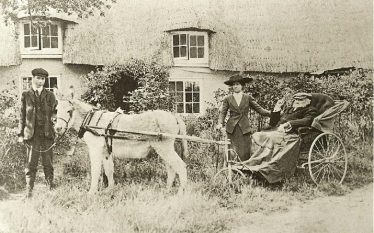 John George Mortlock with one of his daughters outside Orchard Cottage ~1915