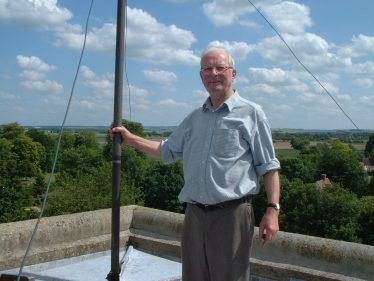 John pictured on top of Holy Trinity Church tower, June 2003
