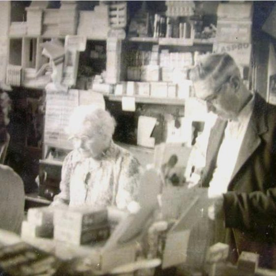Jim Rayner with Mrs Handscombe in the Post Office, High Street, Meldreth. c. 1960 | Photo supplied by Joan Fallon