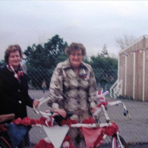 Joan Gipson (left) and Mary Course with their decorated tandem for the Queen's Jubilee parade | Meldreth WI scrapbook
