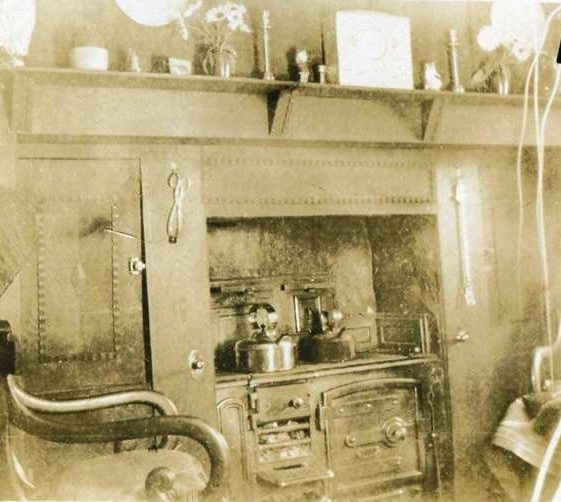 Inside Post Office, High Street, Meldreth showing cooking range in kitchen-cum-living room, home of Mr and Mrs Fred Handscombe. c.1927 | Photo supplied by Teddy Handscombe