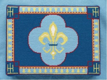 Sandra Ray, Meldreth 2012 | Fleur-de-lis with bell motive on the surround.  Cross stitch.