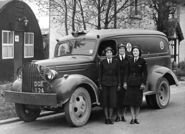 l/r Peggy Palmer, Joan Elbourn and Mary Hoy with the Red Cross ambulance in Meldreth High Street in 1950. | Photo supplied by Mary Hoy