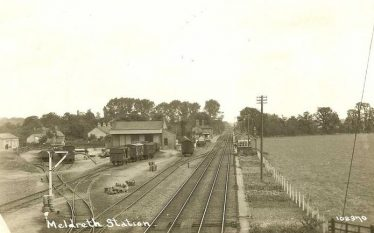 View of Meldreth Station and Goods Yard looking north.  The transhipment warehouse is in the centre left of the photo. ~1925 - 35 | Bells Postcard