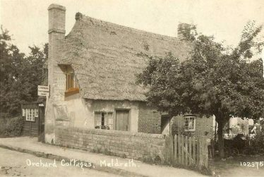 Bramble Cottage ~1930.  The cottage is named Orchard Cottage on this postcard.  Note the sign for Mr Norman, cobbler.  The photo clearly shows that the cottage housed 3 families. | Bells Postcard