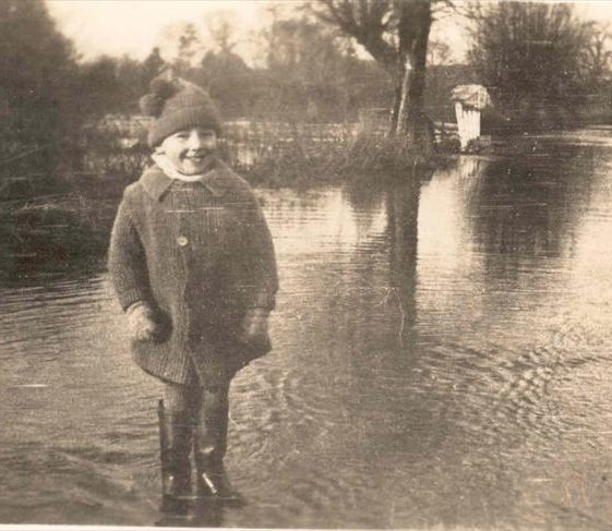 Raymond Course on Malton Lane during the floods c. 1928.  Malton Farm is in the distance, c. 1928 | Photograph supplied by Raymond Course