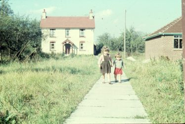 Photograph 4: Norman Cottage in 1959  The two little girls are Julie and Elaine Handscombe aged 4 and 2 respectively. | Ann Handscombe