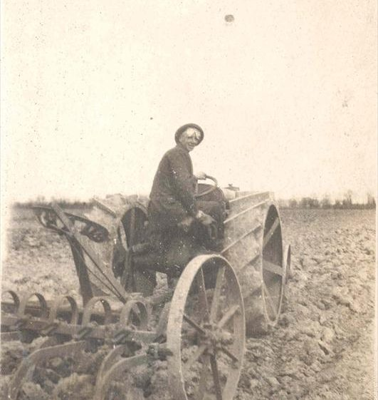 Frank Course on a tractor towing a cultivator at Northfield Farm, c. 1923 | Photograph supplied by Raymond Course