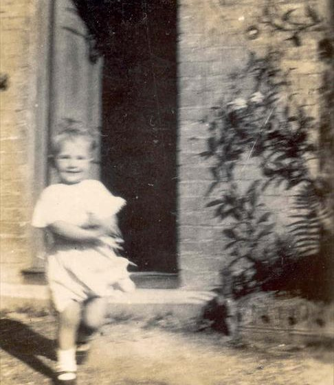 Joan Course in the doorway of Northfield House, c. 1931 | Photograph supplied by Raymond Course