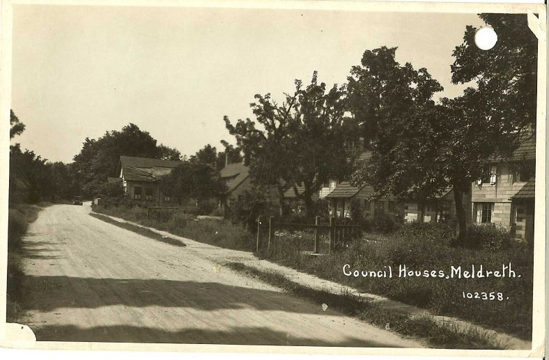 102358 Council Houses, Meldreth [North End; the Parish Room is in the distance]<br> The land for the Council Houses was sold in 1921, and they are likely to have been built 1923-4. The parish room is shown in a dilapidated condition.  It was certainly ruinous by 1942 and was demolished after the war. | Bell's postcard supplied by Ann Handscombe