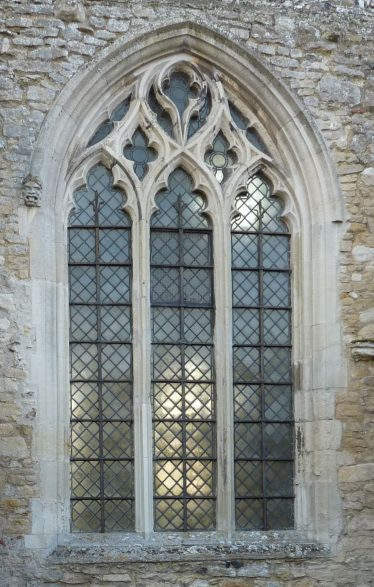 The east window of the north wall of the nave is the most complex of the tracery patterns, with interlocking pairs of ogee arches and an inverted tear drop in the head of the window   Peter Draper