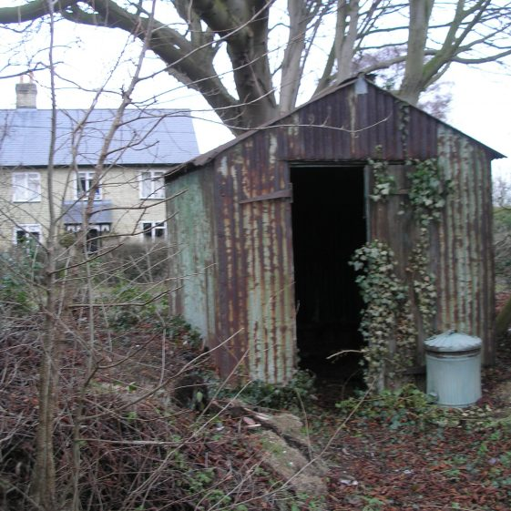 The very dilapidated shed in the Fenny Lane cemetery that used to house the funeral bier.  Photo taken in 2010. | Photo by Tim Gane
