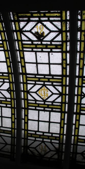 Detail in the stained glass rooflight in Meldreth Court showing John George Mortlock's initials and the date 1894 | Photo by Tim Gane courtesy of Margaret Ryan