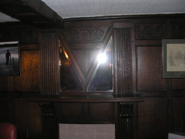 The AM mirror in the Oak Room in Meldreth Court. Note the letter M and the inverted A in the nirror design.  The date of the mirror is now known | photo by Tim Gane