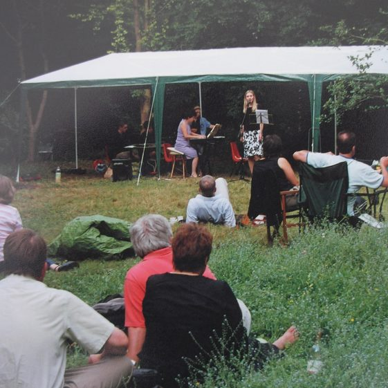 Meldreth villagers enjoying and evening of music and poetry in Melwood | Tim Gane