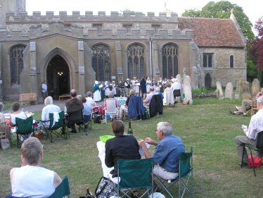 Some of the audience in the churchyard during the perfomance of the Chiltern West Gallery Quire on July 9th 2009 | Tim Gane