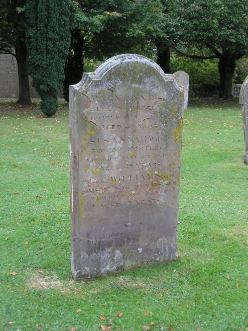 Grave of Mary Ann and Susannah Mortlock (Simeon's second and third wives), plus William, the son of Simeon and his first wife, Martha.  The stone stands in front of Meldreth Church close to the path. | photo by Tim Gane