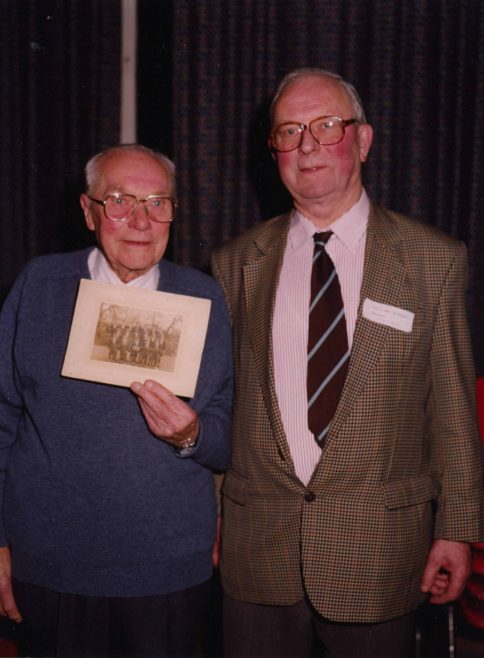 Son Waldock and John Gipson with a photograph of the school's 1925 Australian Rules Rugby team   Photograph courtesy of Meldreth Primary School