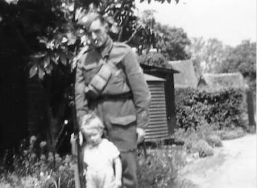 Leslie Pepper with his young son, Brian, pictured during his Home Guard service | Photo supplied by Brian Pepper