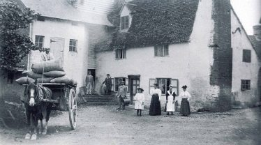 John Reed (on the cart) is pictured with the Peters family outside Topcliffe Mill, c. 1890 | Photograph courtesy of Mary Course