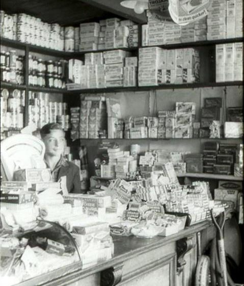 John Smith serving in Post Office and shop, High Street, Meldreth c.1956 | Photo supplied by Ann Handscombe