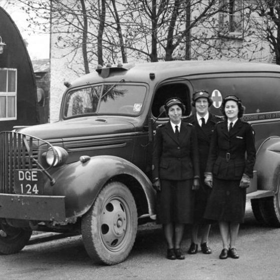 l/r Peggy Palmer, Joan Elbourn and Mary Hoy (nee Dainty) with Red Cross Ambulance in High Street, Meldreth. 1950 | Photo supplied by Mary Hoy