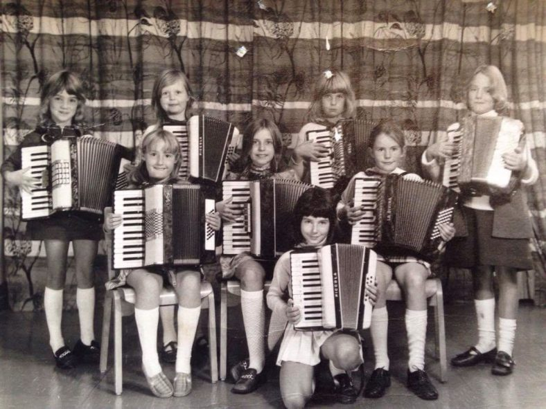 <b>The Rhythm Rascals, 1970-1973</b><br> Back row (standing), from left to right: ?, Belinda Sutcliffe, Susan Berry, ?<br> Middle row (seated), from left to right: Lindy Thomas, ?, ?<br> Front row (kneeling): Suzanne Dummett | Photograph provided by Lindy Thomas
