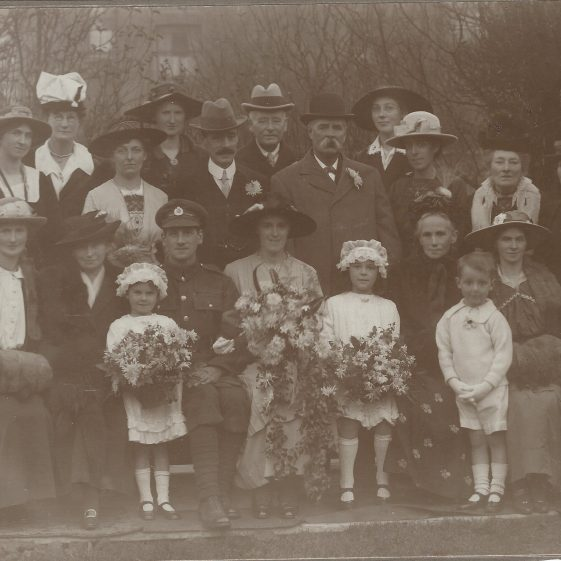 Wedding of George King and Edith Malpress in 1918, probably taken in the garden of the Malpress house, 52 Woodwarde Road, East Dulwich<br> Front row, left to right Grace May Osbourn (née King) - groom's sister & next of kin, Annie Margaret Adcock (née King) - groom's sister, (Standing) Gwen Adcock - groom's niece, George King, Edith King (née Malpress), Evelyn Grace Malpress (later Macaskill, later Gibson) - bride's niece, Eliza Malpress (née Pope) - bride's mother, (standing) Frank Herbert Malpress - bride's nephew, ?Mabel Annie Malpress (née Harber) - bride's sister-in-law; mother of Evelyn and Frank<br> Centre Row left to right: Rosa Mary King - groom's half sister, Lizzie King - groom's half sister, Grace Adcock (née Hart), Harry Adcock (Best Man?), William Malpress - bride's father (this is the only known picture of him), Florence Maud Brown (née Malpress) - bride's sister, ?, ? <br> Rear row left to right: ?, ? Martha Augusta Worland (née King) - groom's half sister, ? James Malpress - bride's uncle, ? | Photograph supplied by Jane Moore (née Findlay). Names supplied by David King.