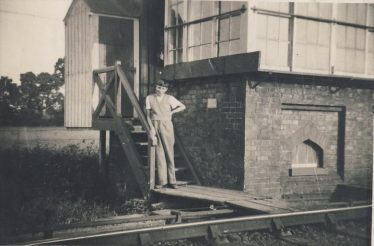 Keith Fost standing on the steps to the signal box in 1936 | Enid Martin
