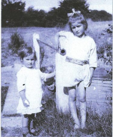 Sylvia with her younger sister Evelyn.  Her brother Norman can just be seen between the sisters. | Photo supplied by Joan Gipson and Chris Duguid