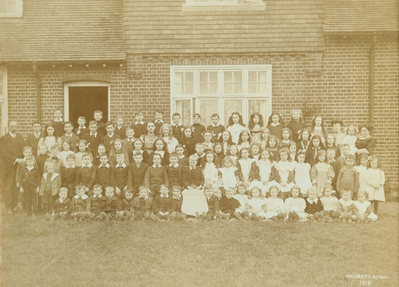 <b>Meldreth School Pupils and Teachers, 1912</b><br> The children in the photograph above are aged from 3 to 12.  It is believed to include the following pupils: Fred Aldridge, Gladys  Aldridge, Vera Barnes, Emily Blows, ? Budget, Ivy Butler, Jubal Butler, Daisy Butler, Florrie Butler, Fred Christmas, Fred Course, Minnie Course, Audrey Course, Lottie Croxall, Charlie Croxall, Jack Dash, Ernie Dash, Lolly Dash, Basil  Dyson, Grace East, Percy Farnham, Arthur Farnham, George Farnham, George Fincham, Harry Folbigg, Nora Green, Edie Green, Percy Hale, George Hale, Stanley Hale, Gladys Harrup, Jack Hodgkinson, Winnie Hodgkinson, Connie Jacklin, Fanny Jacklin, Dora Jacklin, Maud Jacklin, Daisy King, Mary Linsdell, Betty Linsdell, Kitty Linsdell, Bill Linsdell, Edwin Lydall, Ernest Lydall, Gladys Mead, Ethel Mead, Winifred Moxon, Dolly  Moxon, Percy Negus, Gladys Negus, Percy Oakman, Percy Pepper, William Pepper, Walter Plumb, Charlie Plumb, Emily Plumb, Queenie Rayner, Ruby Rayner, Reginald Rumbold, Alice Rumbold, Lewis Simons, Ivy Stallibrass, Fanny Vellam, Sarah Vellam, Arthur Walbey, Jack Wing, Montie Wing, Bert Woodcock, Edna Woodcock, Gwen Woodcock<br> The following members of staff are also pictured:<br> Headteacher: Mr Frederick John Aldridge, Teacher: Miss Maud Stearn, Teacher: Miss Violet Huggins