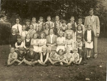 <b>The Entire School in 1948</b><br> Back row, from left: ?, Trevor Jude, Bryn Jones, Robert Webb, Stanley Pateman, Brian Pepper, Michael Hunt, Alan Chamberlain, Heydon Jones, ?<br> Second row, from left: Sheila Clarke, Ann Day, Diana Burgess, John Salmon, Joan Jacklin, Peter Oakman, Beryl Burling, Caroline May, Judith Pearmain<br> Third row, from left: Brian Mead, Arlene Howell, Ruth Adams, Christine Hart, Miss Broughton, Barbara Cox, Felicity Bowen, Ronnie Hunt<br> Front row, from left: Colin Mead, Shirley Hunt, Orton Radford, Phyllis Burling, Ronald Winter, Rita Rumble, Brian Clarke, Barry Clarke | Photograph supplied by Brian Clarke