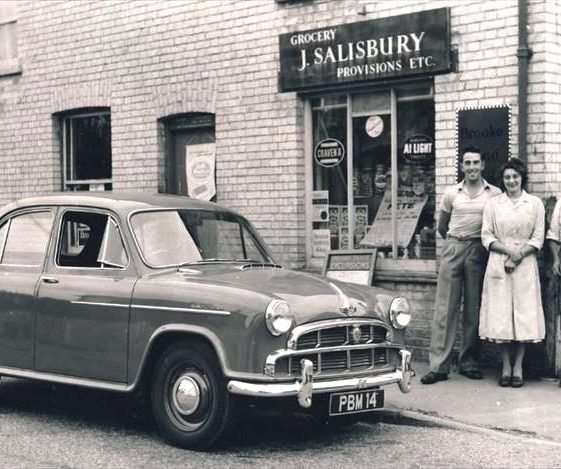Ivan Jacklin, Enid Martin (nee Fost) and Jack Salisbury outside village shop, High Street, Meldreth. 1959 | Photo supplied by Enid Martin