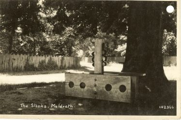 The stocks and whipping post, c. 1930 | Bell's Postcard