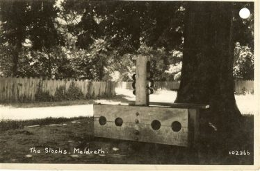 The Stocks on Marvell Green, Meldreth, pictured c. 1930 | Bell's Postcard supplied by Meldreth WI