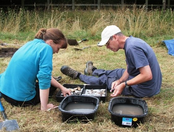 Cat Ranson looks at the finds with Ralph Betts | Photo by Malcolm Woods